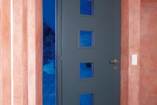 Door with acrylic glass colored blue