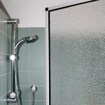 Shower partition made of polystyrene glass